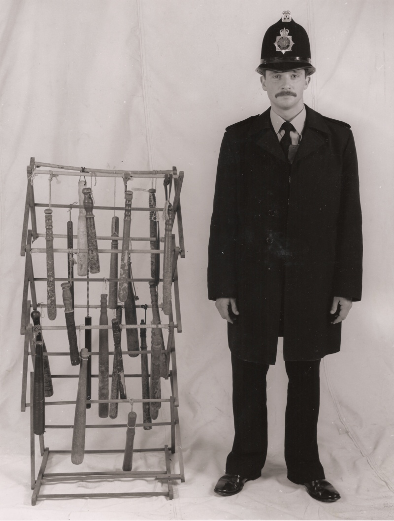 Policeman and Truncheons and Clothes Horse